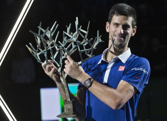 Serbia's Novak Djokovic holds the trophy after winning the final of the BNP Masters tennis tournament in two sets, 6-2, 6-4, against Britain's Andy Murray at the Paris Bercy Arena, in Paris, France, Sunday, Nov. 8, 2015. (AP Photo/Michel Euler)