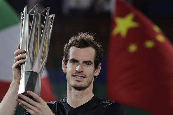 Andy Murray of Britain holds up his winner trophy after defeating Roberto Bautista Agut of Spain in the men's singles final of the Shanghai Masters tennis tournament at Qizhong Forest Sports City Tennis Center in Shanghai, China, Sunday, Oct. 16, 2016. (AP Photo/Andy Wong)